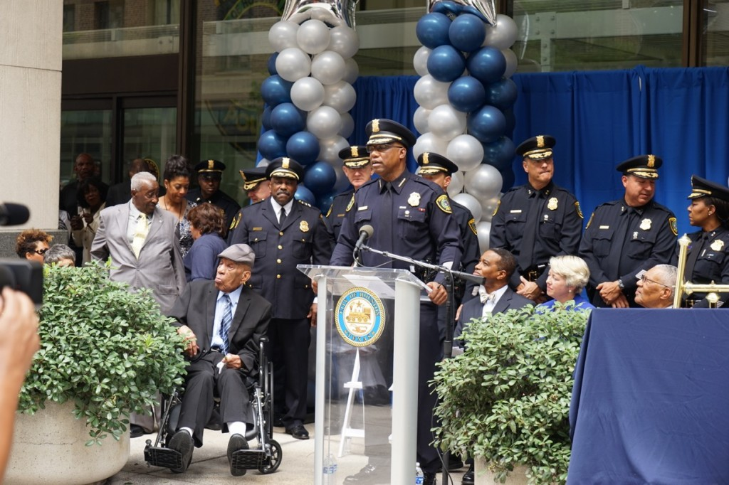Mr. Thomas, seated at the left, was the most frequently photographed individual at the naming ceremony for HPD headquarters on July 27. GARY HICKS PHOTO.